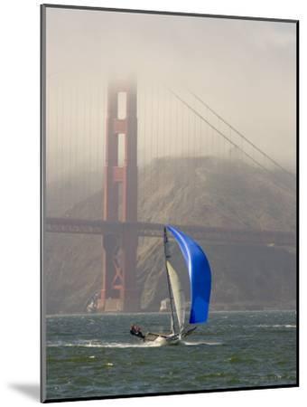 International 14 Skiff Sails under the Golden Gate Bridge, San Francisco Bay, California-Skip Brown-Mounted Photographic Print