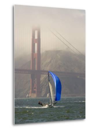 International 14 Skiff Sails under the Golden Gate Bridge, San Francisco Bay, California-Skip Brown-Metal Print