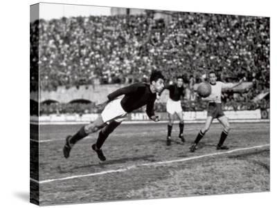 Soccer Player Shown While Heading the Ball-A^ Villani-Stretched Canvas Print