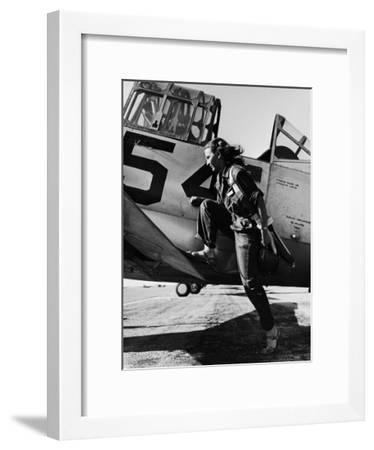 Female Pilot of the Us Women's Air Force Service Posed with Her Leg Up on the Wing of an Airplane-Peter Stackpole-Framed Premium Photographic Print
