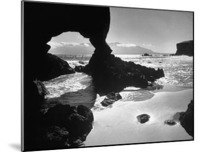 Natural Gateways Formed by the Sea in the Rocks on the Coastline-Eliot Elisofon-Mounted Photographic Print