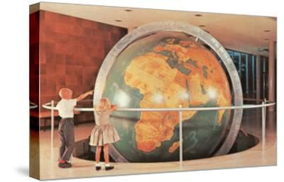 Children Looking at Giant Globe--Stretched Canvas Print