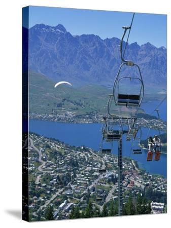 Chair Lift with Lake Wakatipu, the Remarkable Mountains and Queenstown, South Island, New Zealand-Jeremy Bright-Stretched Canvas Print