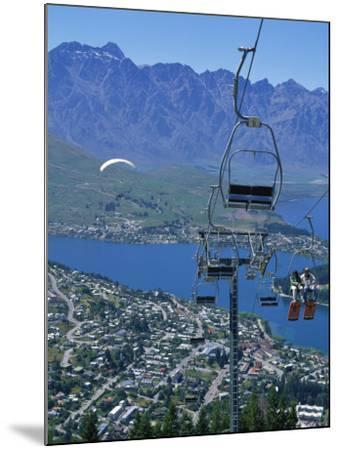 Chair Lift with Lake Wakatipu, the Remarkable Mountains and Queenstown, South Island, New Zealand-Jeremy Bright-Mounted Photographic Print