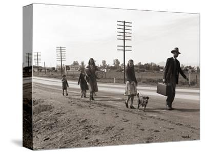 Homeless Migrant Family of Seven, Walking the Highway from Phoenix, Arizona, 1939-Dorothea Lange-Stretched Canvas Print