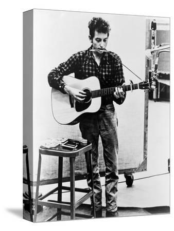 Bob Dylan Playing Guitar and Harmonica into Microphone. 1965--Stretched Canvas Print