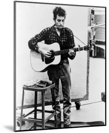 Bob Dylan Playing Guitar and Harmonica into Microphone. 1965--Mounted Photo