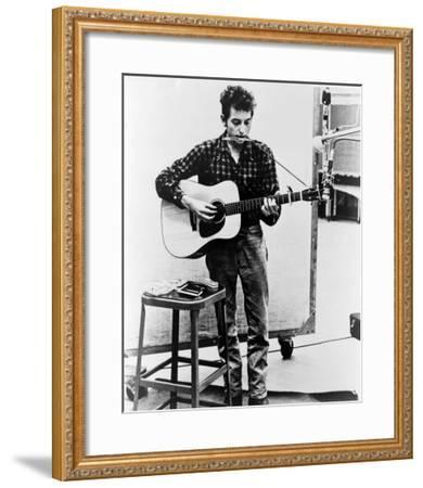 Bob Dylan Playing Guitar and Harmonica into Microphone. 1965--Framed Photo