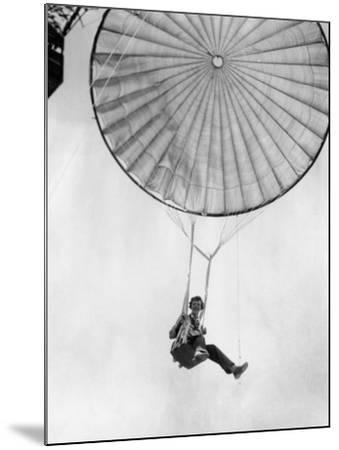 Amelia Earhart Helps Test a Commercial Parachute. June 2, 1935--Mounted Photo