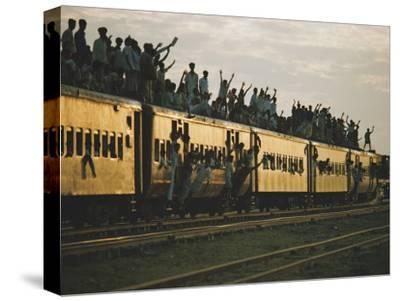 Famine refugees crowd aboard a train bound for the capital, Dacca-Steve Raymer-Stretched Canvas Print