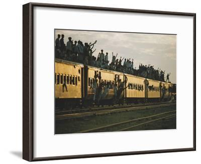 Famine refugees crowd aboard a train bound for the capital, Dacca-Steve Raymer-Framed Photographic Print