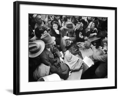 Frenzied Shoppers Crowd around Busy Cashier During Hearn's Department Stores Bargain Rush Sale-Lisa Larsen-Framed Photographic Print