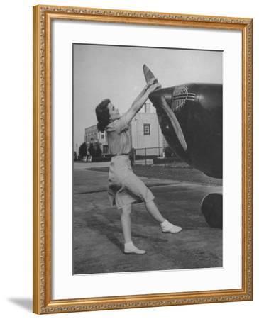 Woman Turning Propeller to Start Plane-David Scherman-Framed Photographic Print