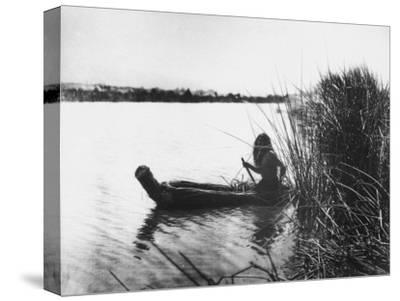 Pomo Indian Poling His Boat Made of Tule Rushes Through Shallows of Clear Lake, Northen California-Edward S^ Curtis-Stretched Canvas Print