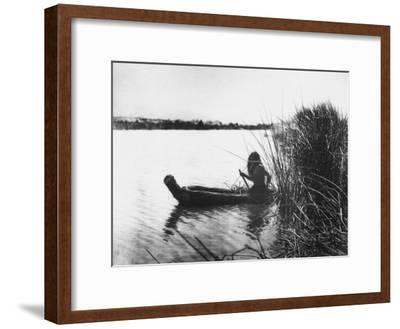 Pomo Indian Poling His Boat Made of Tule Rushes Through Shallows of Clear Lake, Northen California-Edward S^ Curtis-Framed Photographic Print
