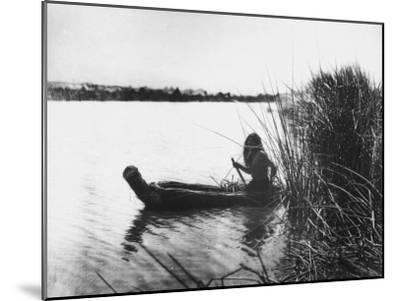 Pomo Indian Poling His Boat Made of Tule Rushes Through Shallows of Clear Lake, Northen California-Edward S^ Curtis-Mounted Photographic Print