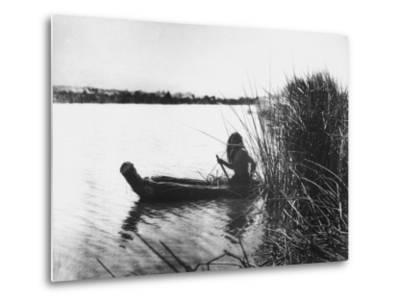 Pomo Indian Poling His Boat Made of Tule Rushes Through Shallows of Clear Lake, Northen California-Edward S^ Curtis-Metal Print