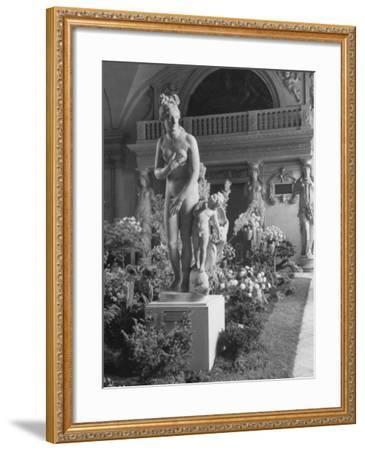 The Statue of Aphrodite and Eros in Louvre Museum During a Flower Show-Dmitri Kessel-Framed Photographic Print