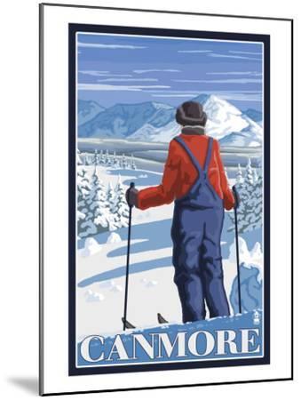 Canmore, Alberta - Skier Admiring View, c.2009-Lantern Press-Mounted Art Print