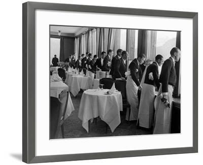 Waiters at the Grand Hotel Line Up at the Windows to Watch Sonja Henie Ice Skate Outside-Alfred Eisenstaedt-Framed Photographic Print