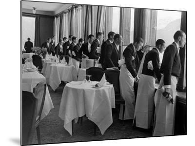 Waiters at the Grand Hotel Line Up at the Windows to Watch Sonja Henie Ice Skate Outside-Alfred Eisenstaedt-Mounted Photographic Print