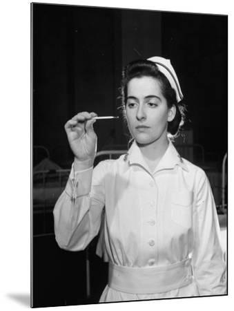 US Navy Nurse in Uniform Reading a Thermometer--Mounted Photographic Print
