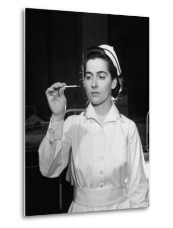 US Navy Nurse in Uniform Reading a Thermometer--Metal Print