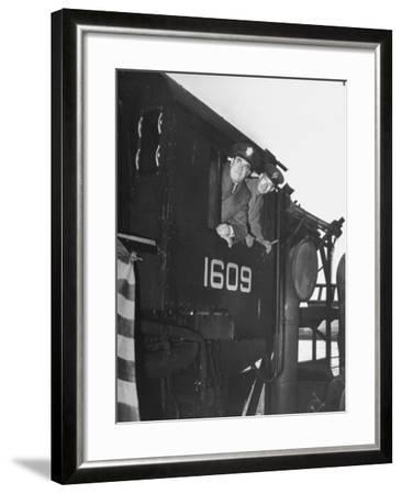 Col. Ryan and Major General Mcmullen Looking Out the Cab of a New Locomotive--Framed Photographic Print