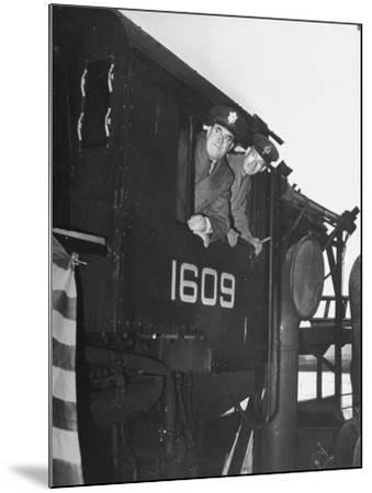 Col. Ryan and Major General Mcmullen Looking Out the Cab of a New Locomotive--Mounted Photographic Print