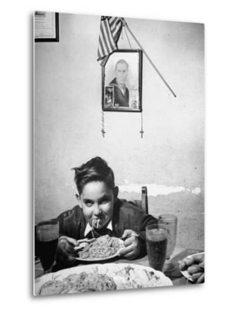 Boy Eating Spaghetti under Picture of His Brother Who Died During Invasion of Sicily--Metal Print