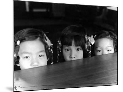 Little Girls Peeking over Rim of Table at California Chinese Mission School-Alfred Eisenstaedt-Mounted Photographic Print