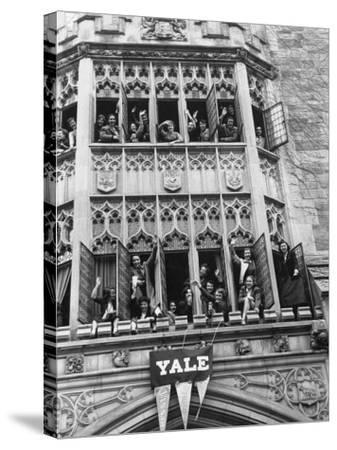 Vassar Girls Cheering Cyclists from Windows-Yale Joel-Stretched Canvas Print
