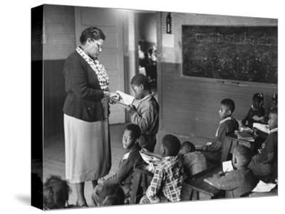African-American Teacher and Children in Segregated School Classroom--Stretched Canvas Print