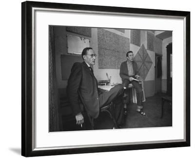 Painter Brion Gysin, Shown W His Paintings in Hotel Room in with Writer William S. Burroughs-Loomis Dean-Framed Photographic Print