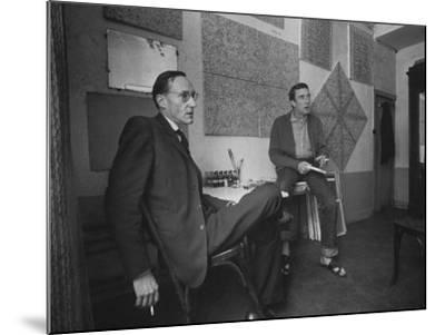 Painter Brion Gysin, Shown W His Paintings in Hotel Room in with Writer William S. Burroughs-Loomis Dean-Mounted Photographic Print