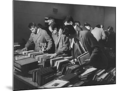 Students Buying Books at a Sale at Harvard University-Dmitri Kessel-Mounted Photographic Print