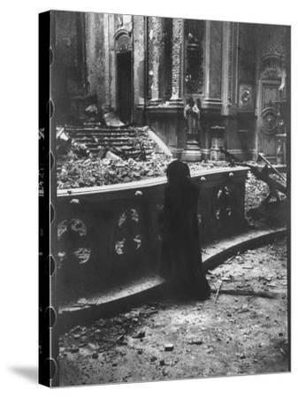 Woman Grieving over Wreckage of Catholic Church Burned During Uprising Against Peron--Stretched Canvas Print