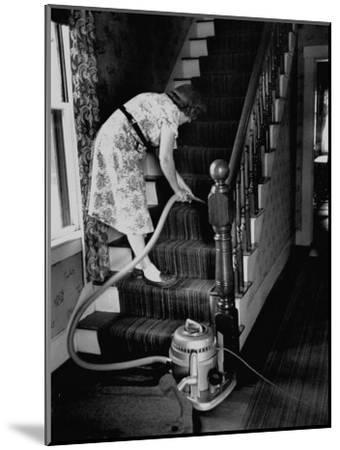 Housewife Cleaning Her Carpet with Vacuum Cleaners-Yale Joel-Mounted Photographic Print