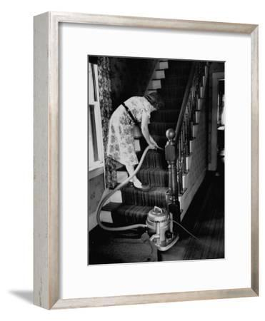 Housewife Cleaning Her Carpet with Vacuum Cleaners-Yale Joel-Framed Photographic Print