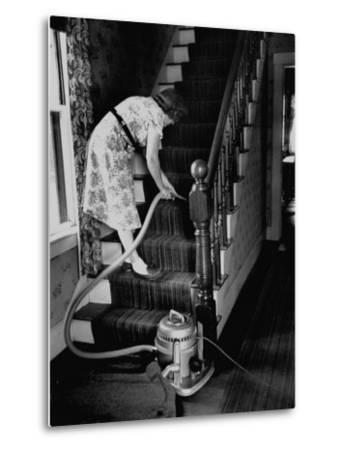 Housewife Cleaning Her Carpet with Vacuum Cleaners-Yale Joel-Metal Print