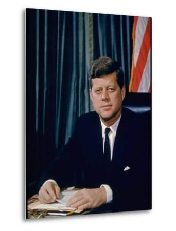 Pres. John F. Kennedy Sitting at His Desk, with Flag in Bkgrd-Alfred Eisenstaedt-Metal Print