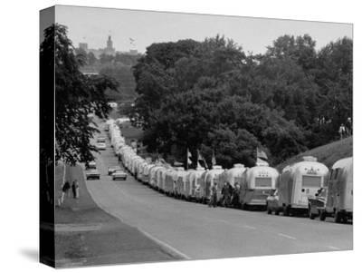 Long Line of Airstream Trailers Wait for Parking Space at a Campground During a Trailer Rally-Ralph Crane-Stretched Canvas Print