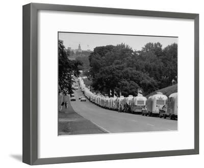 Long Line of Airstream Trailers Wait for Parking Space at a Campground During a Trailer Rally-Ralph Crane-Framed Photographic Print