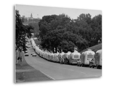 Long Line of Airstream Trailers Wait for Parking Space at a Campground During a Trailer Rally-Ralph Crane-Metal Print