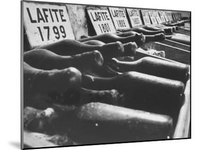Bottles of Lafite Wines, Now Museum Pieces in French Wine Cellar-Carlo Bavagnoli-Mounted Photographic Print