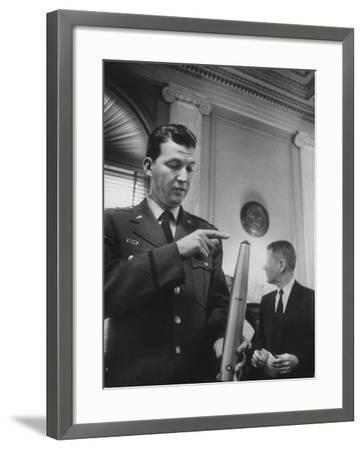Air Force Major General Bernard A. Schriever Looking at a Model of a Rocket--Framed Photographic Print