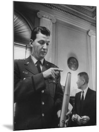 Air Force Major General Bernard A. Schriever Looking at a Model of a Rocket--Mounted Photographic Print
