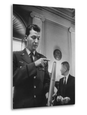 Air Force Major General Bernard A. Schriever Looking at a Model of a Rocket--Metal Print