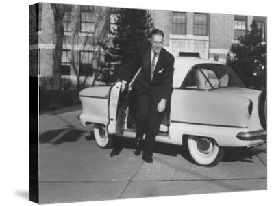 President of American Motors George W. Romney Getting Out of His Car-Grey Villet-Stretched Canvas Print