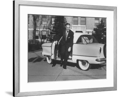 President of American Motors George W. Romney Getting Out of His Car-Grey Villet-Framed Photographic Print